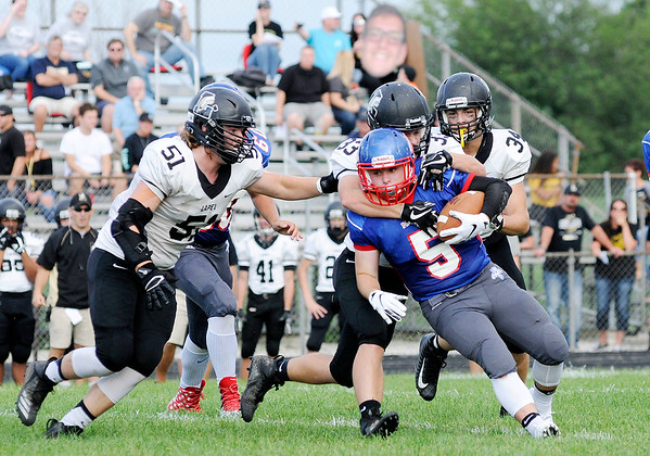 Don Knight | The Herald Bulletin<br /> Lapel's Brandon Wood tackles Elwood's Trenton Porter as the Panthers hosted the Bulldogs on Friday.