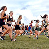 The girls take off for the start of the Lapel Invitational Cross Country meet Tuesday.
