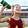 Lilly Thomas, of Alexandria, gives a winning smile as she cools down after finishing first in the Lapel Invitational Cross Country meet Tuesday with a time of 23:07. The Alexandria girls won the team title also.