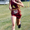 Lilly Thomas of Alexandria finishes strong as she runs the Lapel Invitational Cross Country meet course in 23:07 to win by more then a minute and a half.