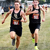 Madison-Grant's Chad Harbert, left, beats out his teammate, Dylan Hofherr by  .01 of a second for sixth place in the Lapel Invitational Cross Country meet Tuesday. Madison-Grant won the team title for the boys.