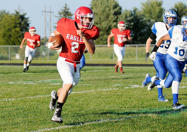 Don Knight | The Herald Bulletin<br /> Frankton's Dru Berkebile runs 59 yards for a touchdown as the Eagles opened their season at home against the APA Jets on Friday.
