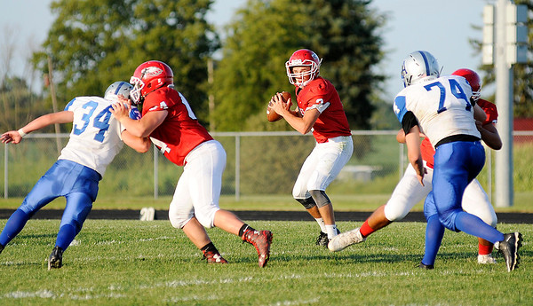 Don Knight | The Herald Bulletin<br /> Frankton's Travis McGuire looks to pass to Noah Vanslyke as he runs a crossing route as the Eagles hosted APA on Friday.