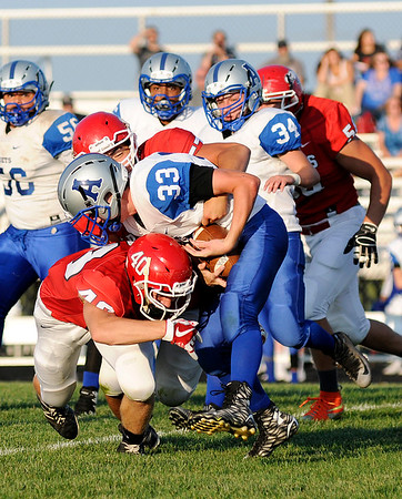 Don Knight | The Herald Bulletin<br /> Frankton's Noah Vanslyke and Michael Turner tackle APA's Tristan Williams on Friday.