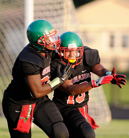 Don Knight   The Herald Bulletin<br /> Jalen Swain, right, and D'Andre Hood celebrate Swain's pick six during Anderson's season opener at home on Friday.
