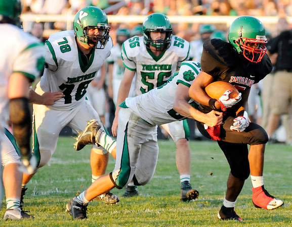 Don Knight   The Herald Bulletin<br /> Anderson's Dayquez McClendon scores on a 10 yard run as the Indians opened their season against Yorktown at home on Friday.
