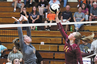 John P. Cleary | The Herald Bulletin Liberty Christian's Mady Rees tries to block Alexandria's Olivia Hall's shot.