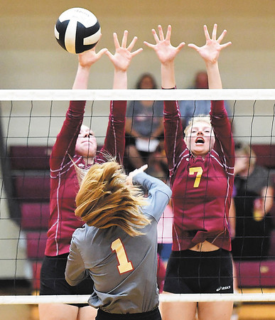 John P. Cleary | The Herald Bulletin<br /> Alexandria's Olivia Hall and Lauren Dungan jump to try to block Liberty Christian's Kaitlyn Smiths.