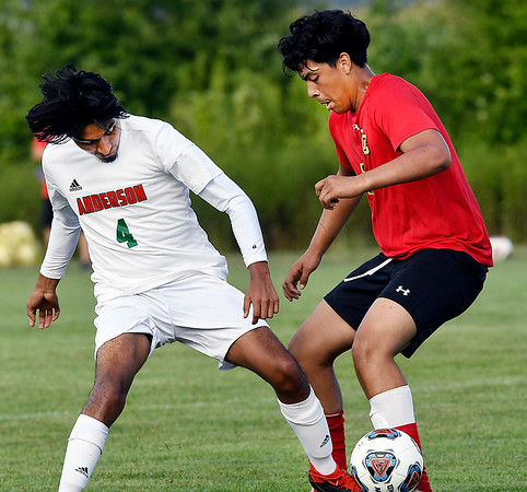 John P. Cleary   The Herald Bulletin<br /> Andersons' Richie Espinoza fights for the ball with Liberty Christians' Josh Cabello during their match Tuesday evening.