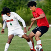 John P. Cleary | The Herald Bulletin<br /> Andersons' Richie Espinoza fights for the ball with Liberty Christians' Josh Cabello during their match Tuesday evening.