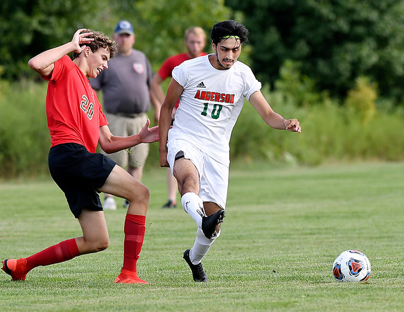 John P. Cleary | The Herald Bulletin<br /> Andersons'  #10, Miguel Contreras, kicks the ball to mid-field as Liberty Christians' Cade McCord tries to defend.