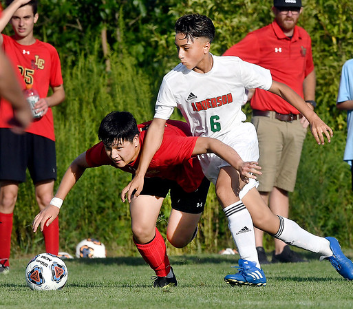 John P. Cleary   The Herald Bulletin<br /> Liberty Christians' Nick Cho and Andersons' Vincent Ibarra fight for the ball during their soccer match Tuesday evening.