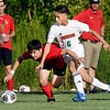 John P. Cleary | The Herald Bulletin<br /> Liberty Christians' Nick Cho and Andersons' Vincent Ibarra fight for the ball during their soccer match Tuesday evening.