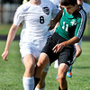 John P. Cleary | The Herald Bulletin<br /> Anderson's Luke Erny fights with Yorktown's Garrett Amburn to gain control of the ball.