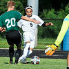 John P. Cleary | The Herald Bulletin<br /> Anderson's mid fielder Johnathan Perez works to get an angle on the goal as Yorktown defender Nathan Reyman moves in to block.