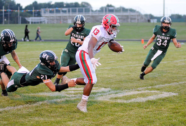 Don Knight | The Herald Bulletin<br /> Anderson's Octavous Anderson breaks a tackle on a punt return as the Pendleton Heights Arabians hosted the Indians on Friday.