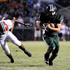 Don Knight | The Herald Bulletin<br /> Pendleton Heights' Joseph Rios breaks a tackle as the Arabians hosted the Anderson Indians on Friday.