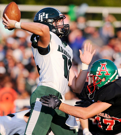 Don Knight | The Herald Bulletin<br /> Pendleton Heights' quarterback Christian Conkling releases the ball as he is hit by Anderson's Jack Gray on Friday.