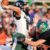 Don Knight   The Herald Bulletin<br /> Pendleton Heights' quarterback Christian Conkling releases the ball as he is hit by Anderson's Jack Gray on Friday.