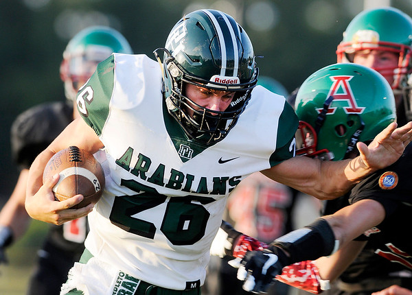 Don Knight | The Herald Bulletin<br /> Pendleton Heights' Evan Douglas scores a touchdown for the Arabians to put them up 7-0 against the Anderson Indians on Friday.