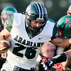 Don Knight   The Herald Bulletin<br /> Pendleton Heights' Evan Douglas scores a touchdown for the Arabians to put them up 7-0 against the Anderson Indians on Friday.