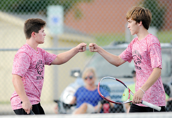 Don Knight | The Herald Bulletin<br /> Frankton's Mitchell Wiley and Landon Weins bump fists after scoring a point against Lapel's Zach Krebs and Reid Ratzlaff at No. 1 doubles during the first round of the Madison County Tennis Tournament on Thursday.