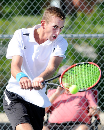 Don Knight   The Herald Bulletin<br /> Lapel's Joseph Conrad returns a volley to Frankton's Keegan Freestone in the No. 1 singles match during the first round of the Madison County Tennis Tournament on Thursday.