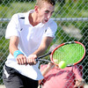 Don Knight | The Herald Bulletin<br /> Lapel's Joseph Conrad returns a volley to Frankton's Keegan Freestone in the No. 1 singles match during the first round of the Madison County Tennis Tournament on Thursday.