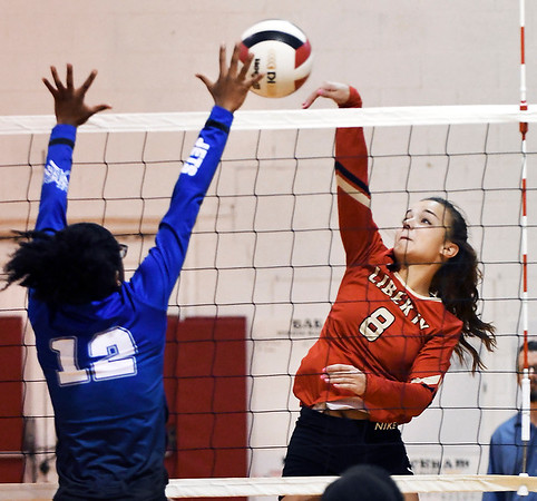 John P. Cleary | The Herald Bulletin<br /> Anderson Prep's Tyra Gillispie tries to block the shot of Liberty Christian's Alayna Thomas.