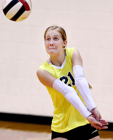 John P. Cleary   The Herald Bulletin<br /> Anderson Prep's Samantha Cox keeps her eyes on the ball as she sets up to return a serve.