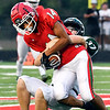 Anderson wide receiver Tremayne Brown gets pulled down by Pendleton's Brennen Adams after catching a pass for a big gain.