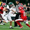 Pendleton's Ethan Ross makes a cutback as Indian defender Chris McKeller tries to grab him.