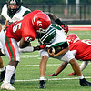 Pendleton's Luke Candiano gets wrapped up by Anderson defender Juwaun Echols on a quarterback keeper.