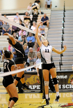 Don Knight | The Herald Bulletin<br /> Pendleton Heights's Aubree Dwiggins sends the ball over the net as Lapel's Delany Peoples attempts to block her on Tuesday.
