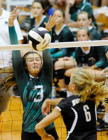 Don Knight   The Herald Bulletin<br /> Pendleton Heights' Brinkley Gary blocks an attack by Lapel's Samantha Voegele at Pendleton on Tuesday.