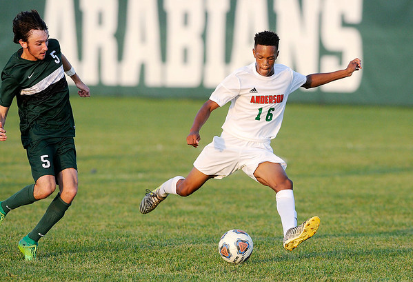 Don Knight | The Herald Bulletin<br /> Anderson's Scott Amos takes a shot on goal as Pendleton Heights' Landon Tyler comes up to challenge him as the Arabians hosted the Indians on Thursday.