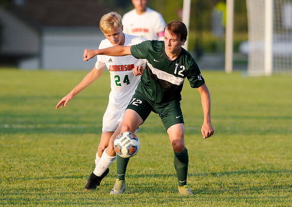Don Knight | The Herald Bulletin<br /> Pendleton Heights' Abe Bohlsen blocks Anderson's Sam Erny to take control of the ball as the Arabians hosted the Indians on Thursday.