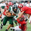 John P. Cleary | The Herald Bulletin<br /> Pendleton Heights Kamden Earley lowers his shoulder as he's about to get hit by Anderson's Malachi Qualls.