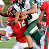 John P. Cleary | The Herald Bulletin<br /> Pendleton Heights Kamden Earley hugs the ball as Anderson's Joseph Jones tries to strip the ball.