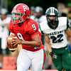John P. Cleary | The Herald Bulletin<br /> Anderson's quarterback M.j. Armstrong rolls out of the pocket as he is being pursued by Pendleton defenders.