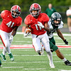 John P. Cleary | The Herald Bulletin<br /> Anderson's Trey Jordan breaks through the line for a good gain for the Indians.