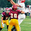 John P. Cleary   The Herald Bulletin<br /> Frankton's Will Whatley can't handle the passl as Alexandria's Camden Peavler comes in to make the hit.