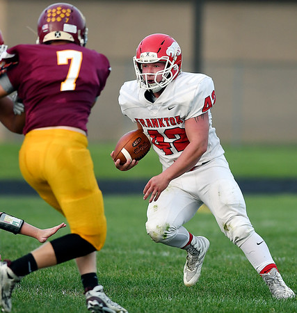 John P. Cleary   The Herald Bulletin<br /> Frankton's Landon Bouslog makes a cut as he follows his blockers to make a gain on the play.