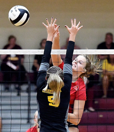 John P. Cleary | The Herald Bulletin<br /> Frankton's Chloee Thomas gets a kill over the outstretched arms of Taylor Stinefield of Alexandria.
