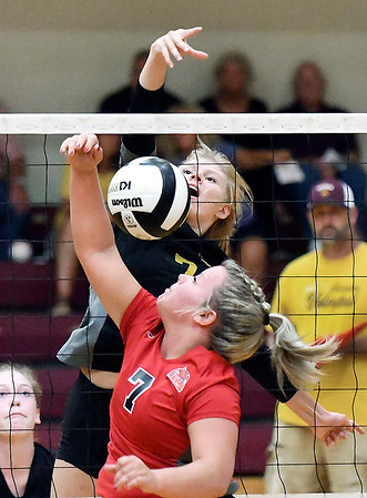 John P. Cleary | The Herald Bulletin<br /> Alexandria's Lauren Dungan slams the ball over the net toward Frankton's defender Aleylah Rastetter.