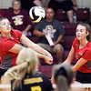 John P. Cleary | The Herald Bulletin<br /> Frankton's Emma Smith and Kate Sperry go after the ball on a serve.