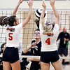 John P. Cleary | The Herald Bulletin<br /> Lapel's #4, Zoe Freer, center, watches her shot be blocked by Frankton's kate Sperry and Audrey Cleek but the ball falls between them and the net.