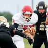 John P. Cleary |  The Herald Bulletin<br /> Frankton's QB Travis McGuire splits defenders on a keeper.
