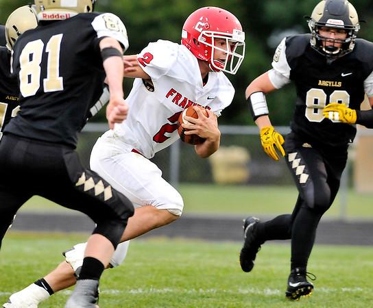 John P. Cleary |  The Herald Bulletin<br /> Frankton's Dru Berkebile breaks into the open for a 56-yard touchdown.