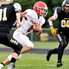 John P. Cleary |  The Herald Bulletin<br /> Frankton's Dru Berkebile breaks into the open for a 56-yard touchdown.